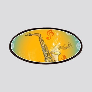 Saxophone with clef in soft yellow, blue color Pat