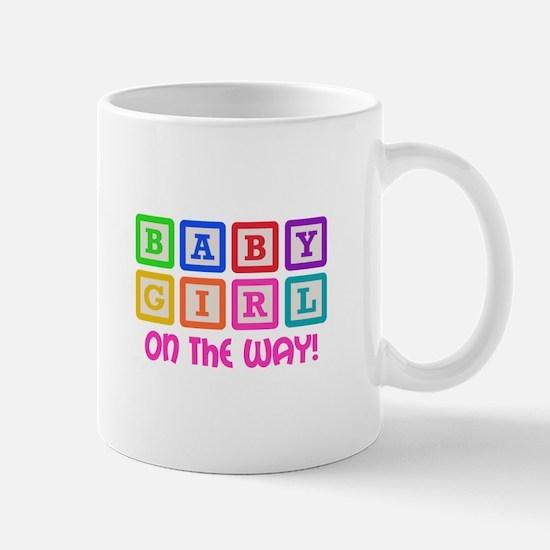 BABY GIRL ON THE WAY Mugs