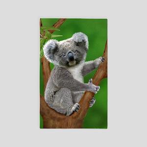 Blue-Eyed Baby Koala Area Rug