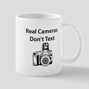 Real Cameras Don't Text Mugs