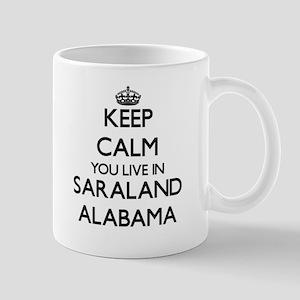 Keep calm you live in Saraland Alabama Mugs