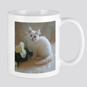 cute siberian colorpoint white kitten Mugs