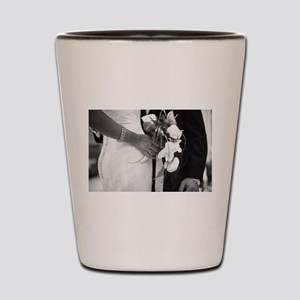 Bride and groom holding black and white Shot Glass
