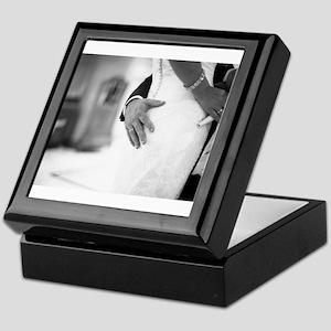 Groom holding bottom of bride black a Keepsake Box