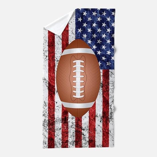 American football ball on flag Beach Towel