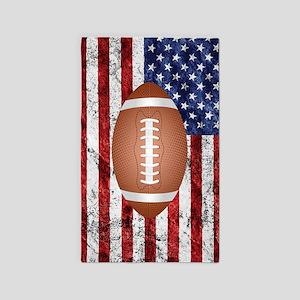 American football ball on flag Area Rug