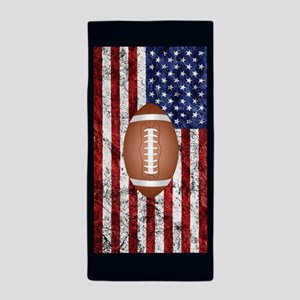 Football on american flag Beach Towel