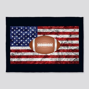 Football on american flag 5'x7'Area Rug