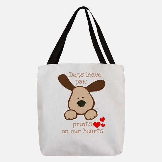 dogs leave paw prints on our he Polyester Tote Bag