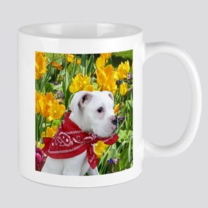 white boxer puppy in tulips Mugs
