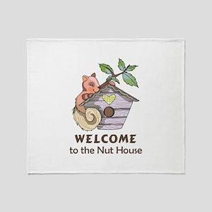 THE NUT HOUSE Throw Blanket