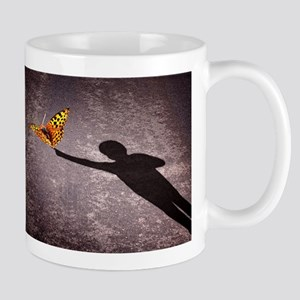 shadow-of-a-little-boy-touching-a-butterfly Mugs