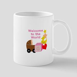 WELCOME TO THE WORLD Mugs