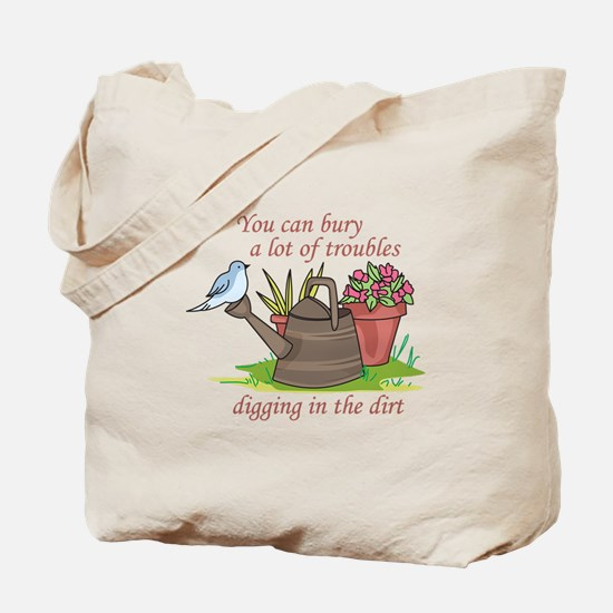 BURY TROUBLES IN THE DIRT Tote Bag