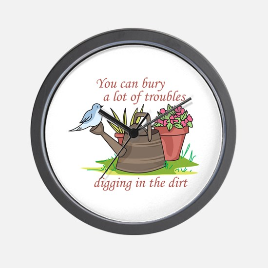 BURY TROUBLES IN THE DIRT Wall Clock