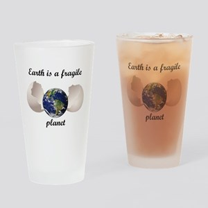 Earth is a fragile planet Drinking Glass