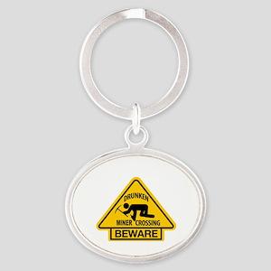 Drunken Miner Crossing Oval Keychain