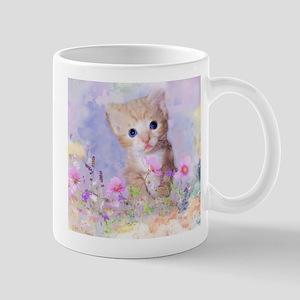 Blue eyed kitten in flowers field Mugs