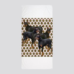 doberman grouping Beach Towel