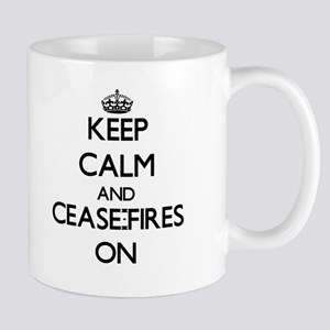 Keep Calm and Cease-Fires ON Mugs