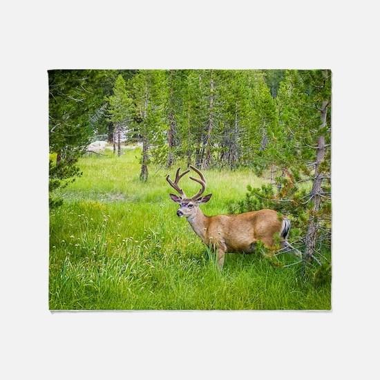 Buck in a Lush Green Meadow Throw Blanket