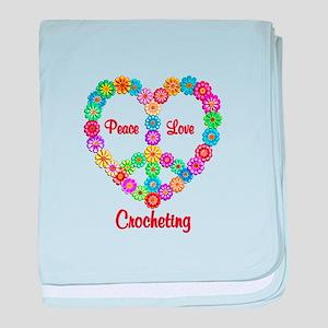 Crocheting Peace Love baby blanket