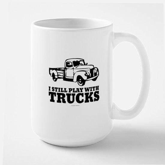I Still Play With Trucks Mugs