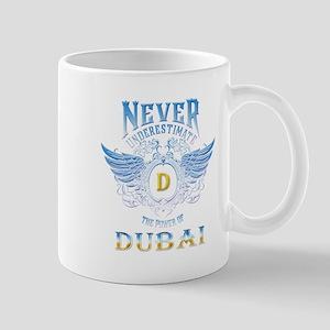never underestimate the power of dubai Mugs