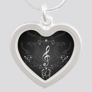 Elegant clef with floral elements Necklaces