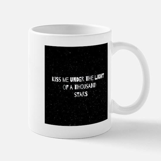 Kiss me under the ight of a thousand st Mug