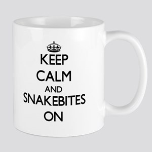 Keep Calm and Snakebites ON Mugs