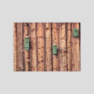 Birdhouses on a Log Wall 5'x7'Area Rug