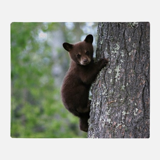 Bear Cub Climbing a Tree Throw Blanket