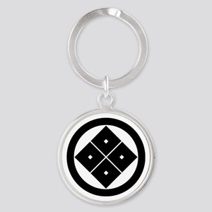 Tilted four-square-eyes in circle Keychains