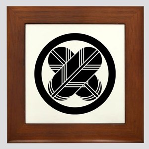 Intersecting hawk feathers in circle Framed Tile