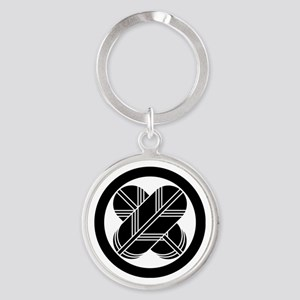 Intersecting hawk feathers in circle Keychains