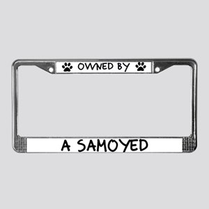 Owned by a Samoyed License Plate Frame