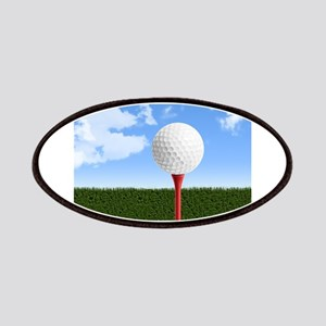 Golf Ball on Tee with Sky and Grass Patch