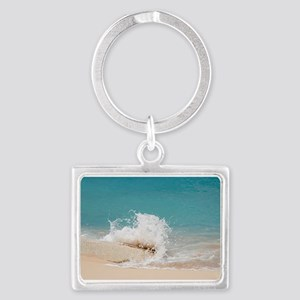 Waves hitting rock at baie rouge beach Keychains