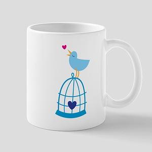 Pretty Bluebird on a cage singing Mugs