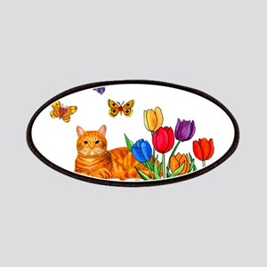 Orange Cat In Tulips Patch