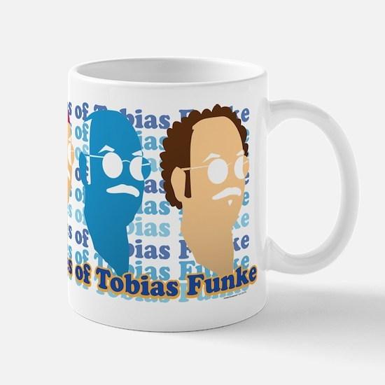 Many Faces of Tobias Mug