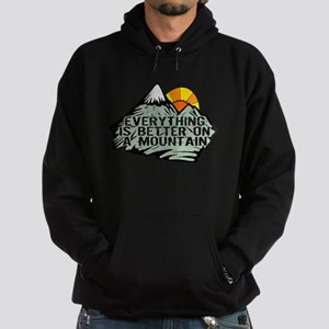 Everythings better on a mountain. Hoodie (dark)