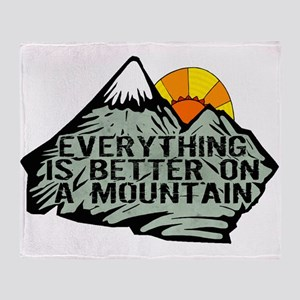 Everythings better on a mountain. Throw Blanket
