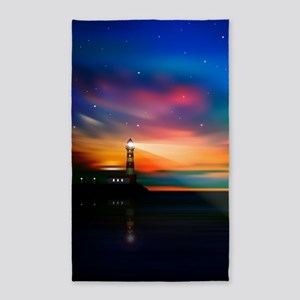 Sunrise Over The Sea And Lighthouse Area Rug
