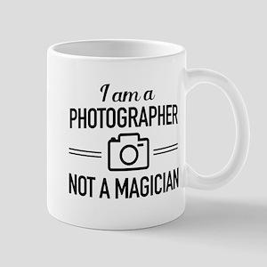 I Am A Photographer Not A Magician Mugs
