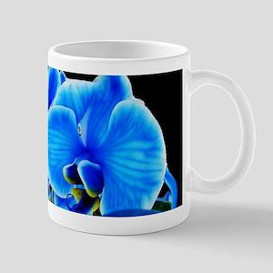 Blue orchid photo on black Mugs