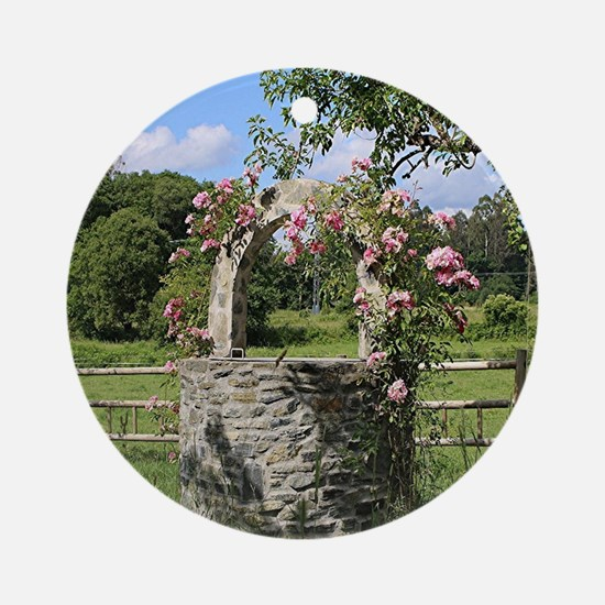 A farm wishing well with roses, El  Round Ornament