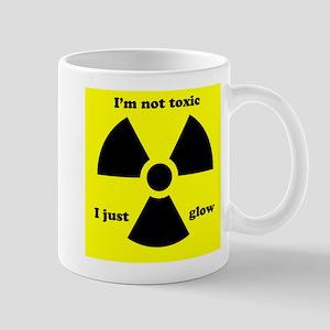 I'm not toxic I just glow Mugs