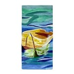 Boat at Sea Beach Towel